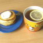 Tea, pancakes with sour cream — Stock Photo