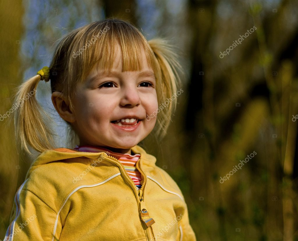 The little girl in spring park looks at a sunset — Stock Photo #1419889