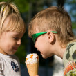 children eat icecream — Stock Photo