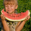 Stock Photo: Little boy with watermelon