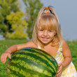 Little girl with watermelon — Stock Photo #1423452