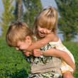 Little girl and boy - Stock Photo