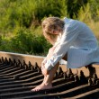 Woman and railroad — Stock Photo #1423535