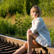 Woman and railroad — Stock Photo