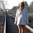 Stock Photo: Woman and railroad
