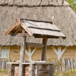 Hut and well — Foto Stock