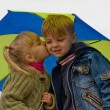 Little boy and girl with umbrella — Stock Photo #1425884