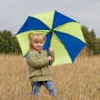 Little girl with umbrella — Stock Photo #1425972
