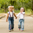 Young girl-friends go for a walk the park — Stock Photo #1426189