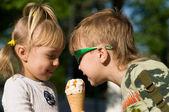 Children eat icecream — Stock Photo