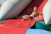 Girl on water slide — Stock Photo