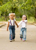 Young girl-friends go for a walk the park — 图库照片