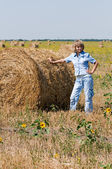 Haystack and girl — Stock Photo