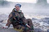 Woman on river bank — Stock Photo