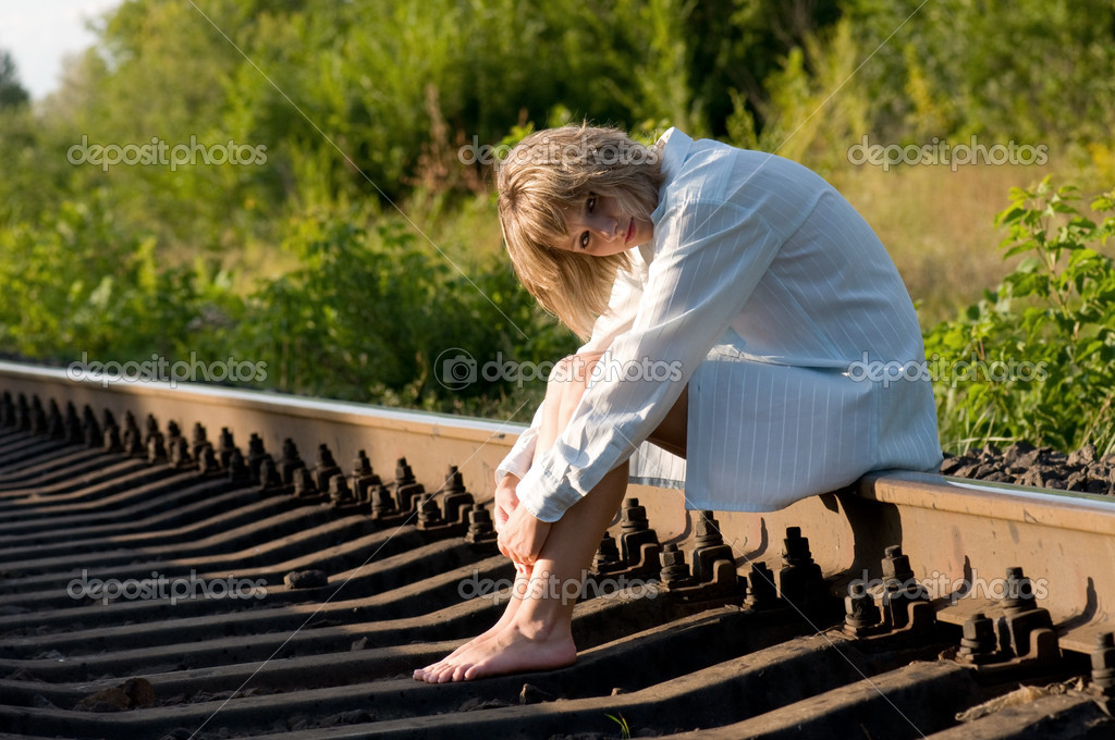 The beautiful young woman, sits on the railway — Stock Photo #1423535