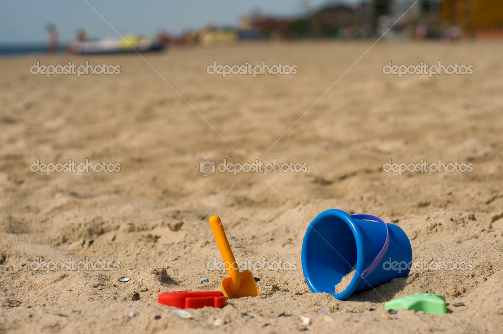 Kid's sand blue pail on beach  Stock Photo #1425078
