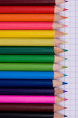 Multicolor pencils on paper — Stock Photo
