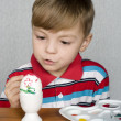 Boy and easter eggs — Stock Photo