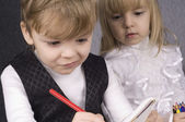 Girl and boy drawing — Stock Photo