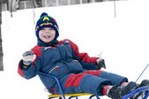 Boy on sledge — Stock Photo