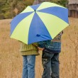 Little boy and girl with umbrella — Stock Photo #2424542