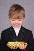 Boy and gift box — Stock Photo