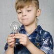 Boy and light bulb — Stock Photo