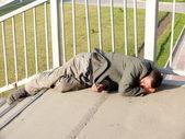 Homeless alcoholic in the bridge — Stock Photo