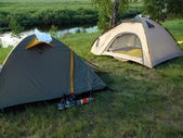 A couple of tent in river background — Stock Photo