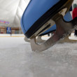 Blue figure skate in the ice — Stock Photo