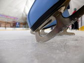 Blue figure skate in the ice — Foto Stock