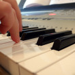 Stock Photo: Hand with piano keyboard