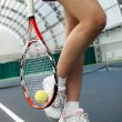 Womplaying tennis — Stock Photo #1416075