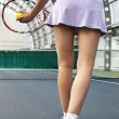 Young woman playing tennis — Stock Photo #1429644
