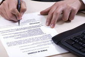 A signing of document — Stockfoto
