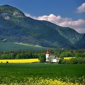 Mountain and old church — Stock Photo