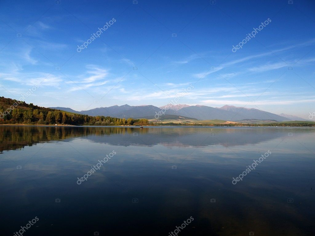 Reflection of mountains in deep lake.  Stock Photo #2416173