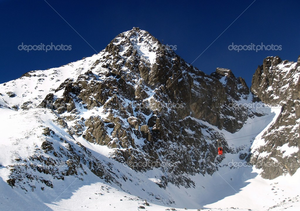 The view of The Lomnicky Peak in winter. It is most popular peak of The High Tatra Mountains, Slovakia.  Stock Photo #2423653