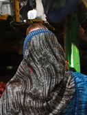 Woman in bright sari in market — Stock Photo