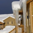 Large icicles on Townhouses - Stock Photo