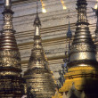 Golden spires of Buddhist stupas — Stock Photo
