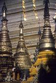 Golden spires of Buddhist stupas — Stock Photo