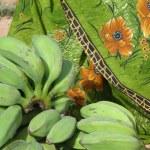 Постер, плакат: Green bananas and sari