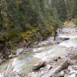 Rapids, blurred whitewater on river rocks - Stock Photo
