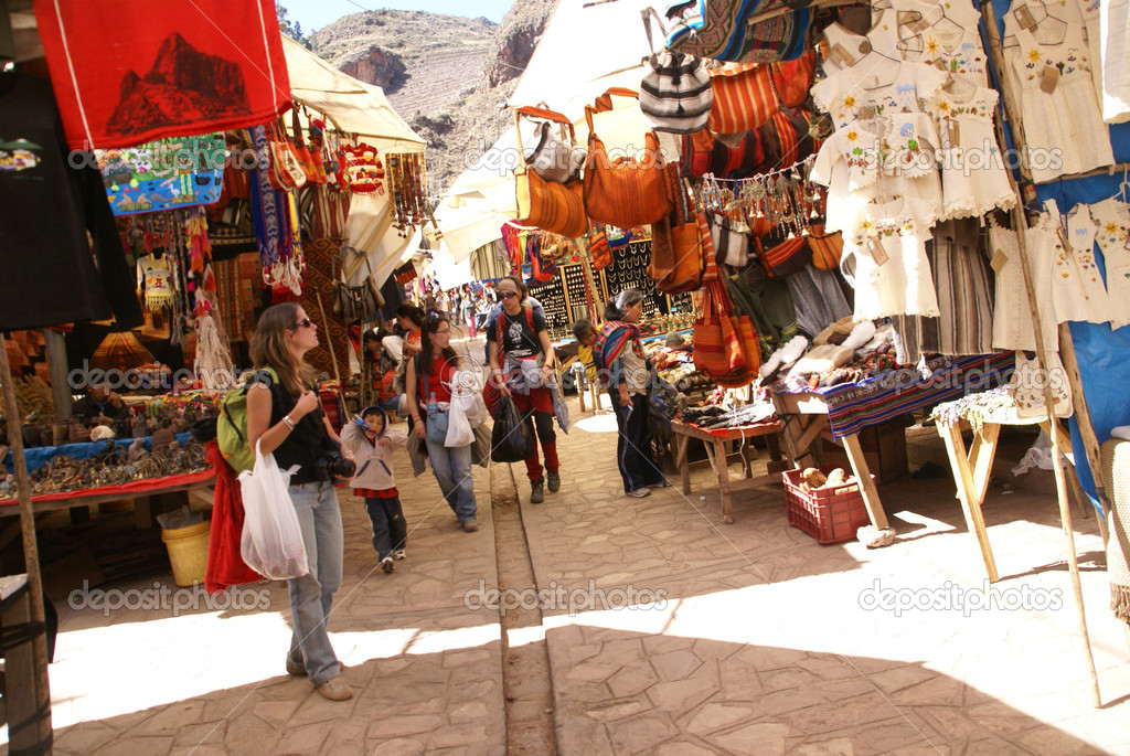 CUSCO, PERU - AUG 28 -  Tourists look for local crafts in the stalls of the Pisac Market on Aug 28, 2008 near Cusco, Peru.  Stock Photo #1620277