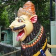 Stock Photo: Lion statue guarding Shivtemple
