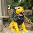 Lion statue guarding Shivtemple — Stock Photo #2006261