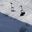 Chairlifts on high mountain ski area - Stock Photo