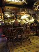 Patrons sit at the old western bar — Stock fotografie
