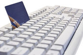 Credit card on a computer keyboard — Stock Photo